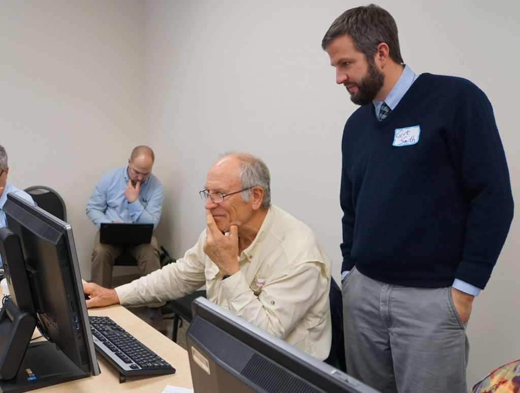 Curt Smith (right), Director of Planning for Accomack-Northampton Planning District Commission, trains Northampton County Supervisor Granville Hogg how to use the Coastal Resilience Tool.