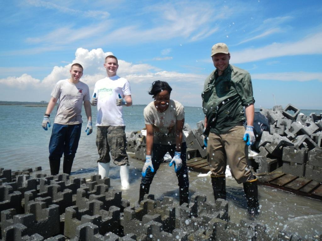Building oyster castles at Boxtree Farm. Photo © Bo Lusk / The Nature Conservancy
